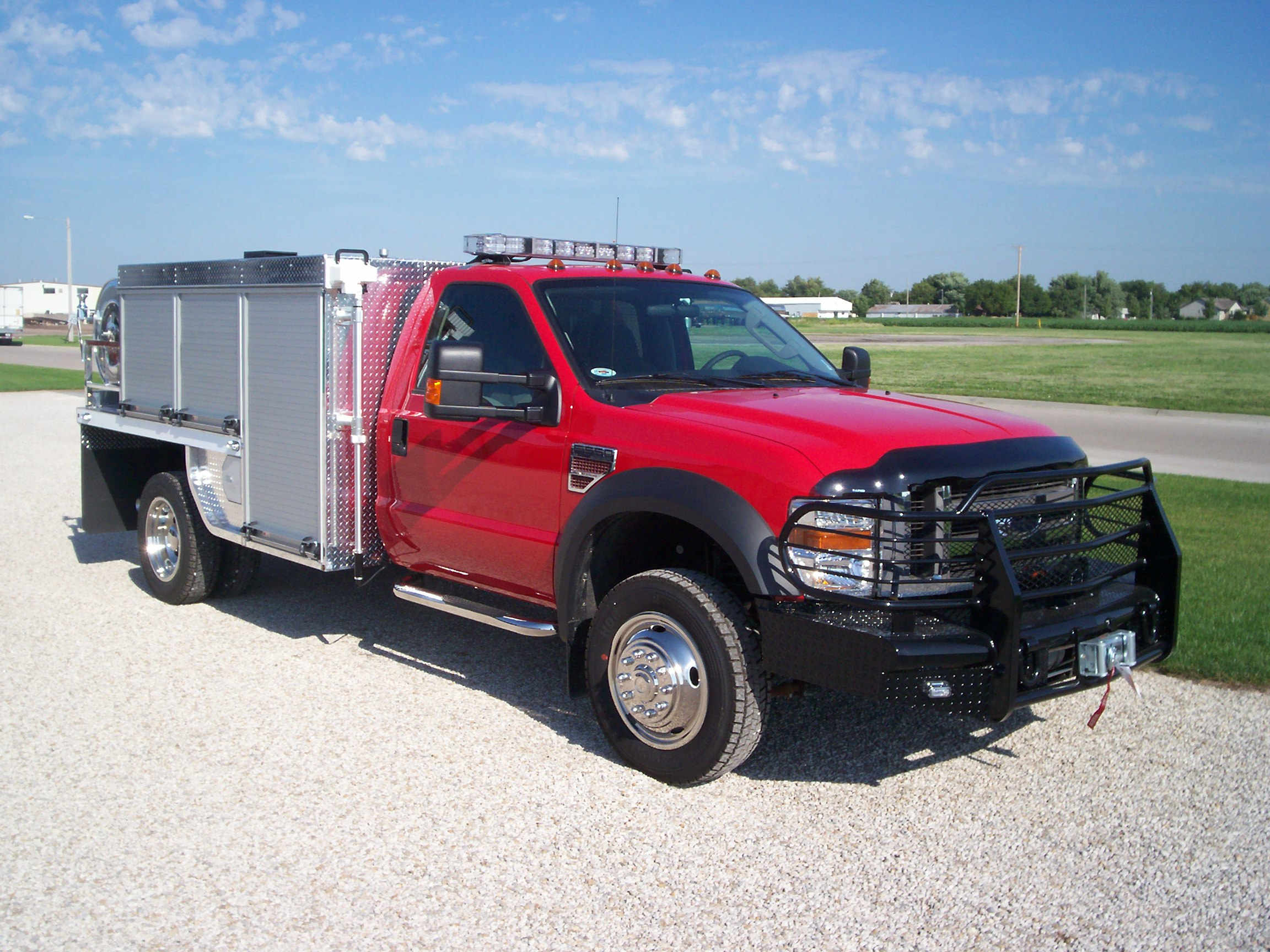 This vehicle offers brush truck features and configuration with a transverse rescue-style compartment. & Brush Truck Rescue Compartment - Unruh Fire